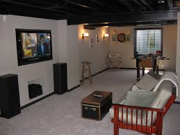 How To Decorate A Small House On A Budget by Diy Finished Basement Notice How Painting Ceiling Beams And