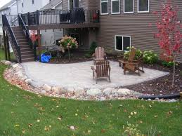 back yard patio with drainage swale along side sarah lloyd