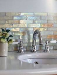 copper backsplash tiles kitchen surfaces pinterest copper faucet paired with solid surface countertops iridescent