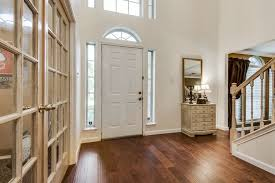 traditional entryway with transom window hardwood floors in