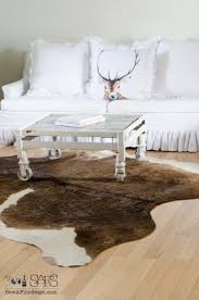 Cowhide Rug In Living Room A Chandelier And A Cow Hide Rug Sew A Fine Seam