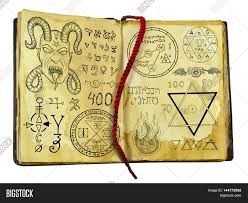 spooky symbols old witch book with demon fantasy and mystic symbols isolated on