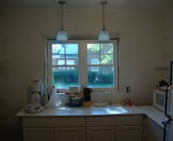 lighting over bathroom sink lighting heightened bathroom mirror