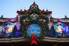 a guide celebrating christmas at disneyland paris