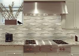 mosaic tile for kitchen backsplash our kitchen tile backsplash is a mixed glass and metal tile