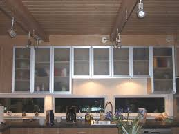 beautify the kitchen by using corner cabinet glass doors modern