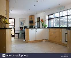 limestone floor tiles in modern country kitchen dining room stock
