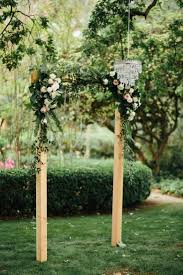 wedding arch leaves simple wooden ceremony arch with flowers and leaves hanging