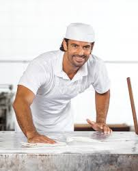 Cleaning Table Stock Images Royalty by Confident Male Baker Cleaning Flour From Table Stock Photo Image