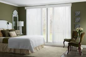 decor modern bedroom with vertical graber blinds and wall decoration