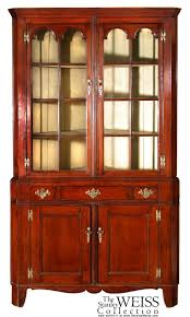 cherry wood corner cabinet a chippendale cherrywood corner cupboard with arched glazed doors
