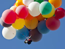 man crosses carolina skies in cluster balloon chair wral com