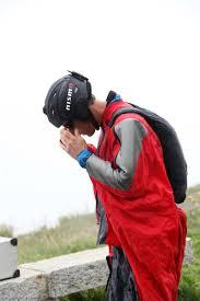 nissan 370z vs golf r nissan cars news 370z nismo races wingsuit man in swiss alps