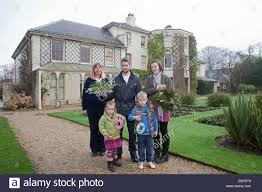 Natural Christmas Decorations For Outside by A Family Pose Outside Down House After Attending The Natural Stock