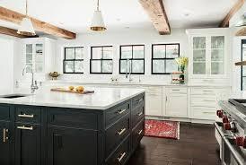 white kitchen cabinets with wood beams black kitchen island kitchen remodel small kitchen