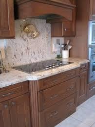 full height granite backsplash persian pearl lumi white serra