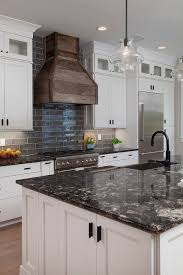 what color countertop goes with white cabinets white cabinets with black countertops 12 inspiring designs