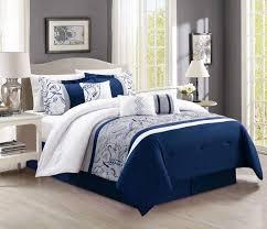 dark grey simple bed grey carpet white bedding silver iron bedside