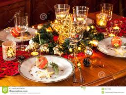 christmas eve dinner party table setting with decorations royalty