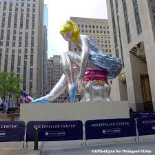 jeff koons 45 foot inflated seated ballerina takes on rockefeller