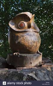 wooden owl sculpture in the woodland walk at burton agnes