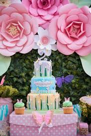 check out this paper flower backdrop at a butterflies and flowers