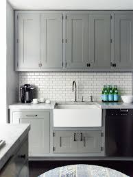 mini subway tile kitchen backsplash white subway tile backsplash gray recessed panel cabinets