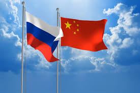 China Flag Waving Russia China To Mull Joint Response To Us Missile Shield