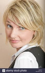 hairstyles suitable for 42 year old woman portrait of a 42 year old woman with highlighted blonde hair stock