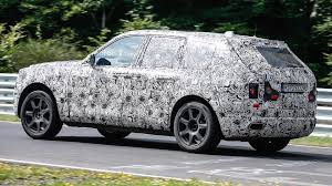 rolls royce cullinan vs bentley bentayga rolls royce cullinan suv caught racing on the u0027ring