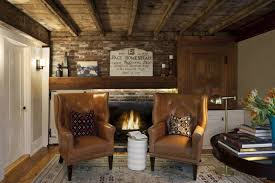 natural stone wall old house interiors with warm fireplace mantle