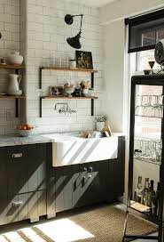 kitchen wall cabinets vintage black and white vintage kitchen with black plank cabinets