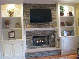 cute tv over fireplace