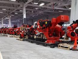 robots invade california tesla installs hundreds of robots at