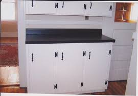 white kitchen cabinets with black laminate countertops monsterlune