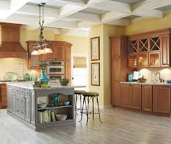 what color wood floor looks with cherry cabinets cherry cabinets with a gray kitchen island schrock