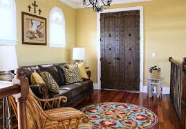 decorating with crosses on wall family room eclectic with cow hide