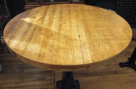 refurbished round butcher block table with heavy cast iron base