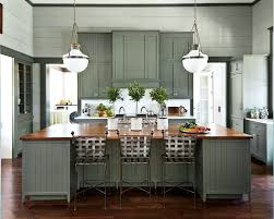 green kitchen cabinets with white countertops 7 paint colors we re loving for kitchen cabinets in 2021