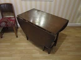 dark wood drop leaf table large vintage dark wood drop leaf dining table with ornate legs