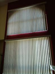 vertical blinds on upper and lower windows window blinds