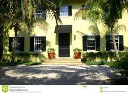yellow house red door black shutters