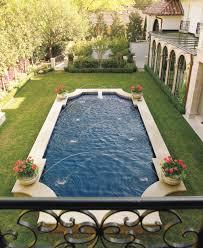 classic pool shape raised off of ground plunge pools