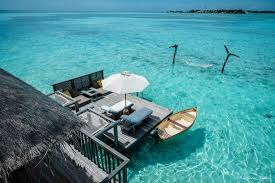 stunning maldives hammock over water sun deck private boat and