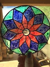 peel and paint a cd to put new spin on sun catchers make