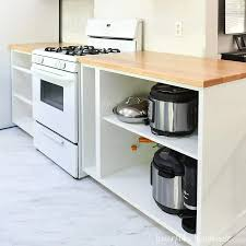 blue kitchen cabinets with wood countertops how to build seal wood countertops houseful of handmade