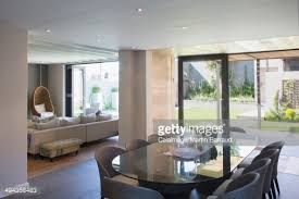 sunny modern luxury home showcase dining room open to balcony