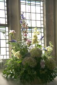 church window with country style flowers www thelilylocket co uk