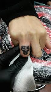 great and simple owl tattoo idea on finger golfian com