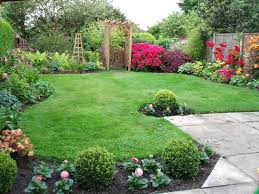 garden sleepers and maintenance free shrubs low fencing ideas